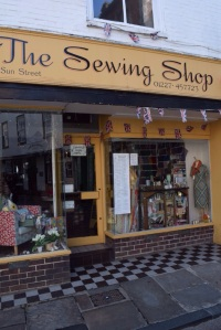 Love the window of this sewing shop, very vintage